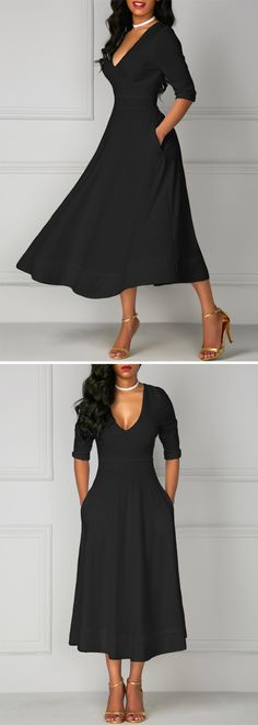 Black half/sleeves dress with pockets. Love the tea length too.