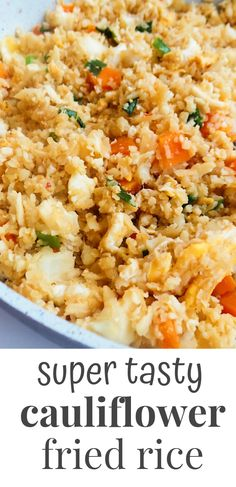 A super delicious easy cauliflower fried rice recipe from scratch - done in less than 30 minutes, even if you only have a grater and no food processor or cauliflower rice! This is a very tasty healthy dinner option that is also low-carb, gluten-free and vegetarian. To make it paleo - use coconut aminos! #dinnerrecipes
