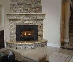 Love this for a corner #fireplace! #stone (Quadra-Fire QFI35 Gas Insert)