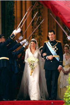 KING FELIPE AND QUEEN LETIZIA ORTIZ OF SPAIN Prince Felipe of Spain and Princess Letiza tied the knot, complete with sword salute, in May 2004. #RoyalWeddings Royal