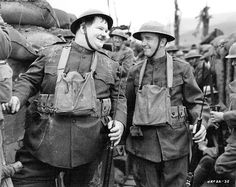 Britishborn actor Stan Laurel and his comedy partner American actor Oliver Hardy wear military uniforms in a trench in a still from director John G. Great Comedies, Classic Comedies, Classic Movies, Laurel Et Hardy, Stan Laurel Oliver Hardy, Comedy Duos, Sound Film, Abbott And Costello, Movies