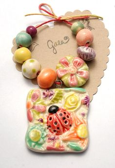 I bought this, can't wait to get it!!Protecting / Summer Ceramic Ladybug Pendant and Bead Set by gaea