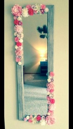 Simple DIY mirror frame. Cheap frame from Home Goods. Add silk flowers