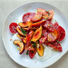 Heirloom Tomato and Nectarine Salad with Whipped Feta   In this dish, feta cheese is whipped into a delicious savory cream and served beneath beautiful slices of summer heirlooms and nectarines.