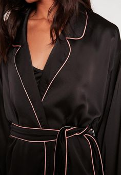elevate your nightwear into something special and slip into this luxe silk robe - featuring contrast rose pink piping, a classic black hue and a kimono style.
