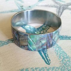 Hey, I found this really awesome Etsy listing at https://www.etsy.com/listing/288517287/abalone-bracelet-wide-sterling-silver