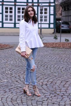 selfmade asymmetrical white blouse combined with ripped jeans | lauracoeur.com