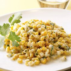 Recipe of the Day: This super-easy Coconut Creamed Corn is a perfect summer side dish ready in under 20 minutes. Light coconut milk brings an out-of-the-box twist to sweet summer corn cut straight from the cob. Perfect for a weeknight dinner or to bring to your next barbecue! #corn #summer #healthyrecipe #sidedish #cornrecipe #coconut #coconutmilk
