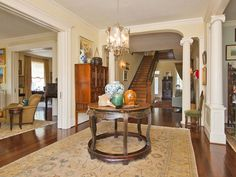 The grand entry hall leads to a handsome oak stairway.