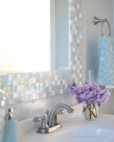 DIY mosaic tile border for a mirror - from Centsational Girl