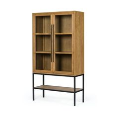"""Solid oak and black-finished iron fuse for a straightforward look with impact. Glass-front doors offer a peek inside to favorite books and treasures, with lower open shelving for even-more styling options. Overall Dimensions:47.00""""w x 19.00""""d x 86.50""""h Boutique Interior Design, Interior Design Companies, Glass Front Door, Front Doors, Kids Decor, Home Decor, Oak Cabinets, Fine Linens, Fall Collections"""