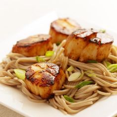 This Japanese-inspired dish uses one sauce�a sweet/salt combination of mirin and miso�to make both the marinade for the scallops and the caramelized pan sauce for the noodles. A good pairing would be a simple green salad dressed with a citrus vinaigrette.