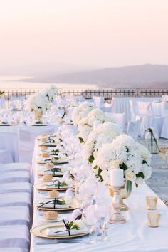 All-white greek wedding reception. Make certain you have a few contrasting pops of color like gold or greenery o both.