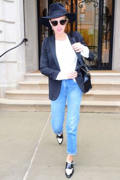 Amber Heard hits the streets in a borrowed from the boys look—cuffed jeans with Jimmy Choo loafers, a satin blazer and KREWE du optic sunglasses .