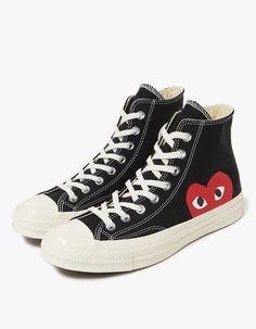 Classic high top sneaker from Comme des Garçons Play in collaboration with  Converse in Black. 17a9ae5d9