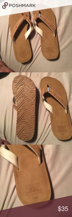 Tom cork flip flops Toms cork flip flops. Never worn. No longer have the box but have the dust bag. They're size 8, but fit more like a 7. The bottoms are leather, the strap is cork material. Toms Shoes Sandals