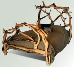 Of course a forest loving gal would want to sleep in a bed like this.  Juniper Log Bed  Great Lakes Rustic - only $2,400