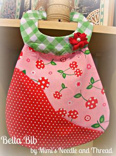 These bibs are bib, bold and beautiful    11 x 9    has a rick rack handmade flower with a pearl center    100% cotton fabrics    velcro closure    fully lined    machine wash and dry, ironing is ok    In stock and ready to ship to anywhere in the world