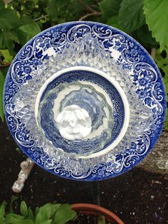Blues and whites with white rose center.  MiMi's Plate Flowers