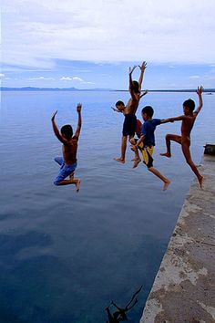 Yipee! everyone loves a good jump off of a rock! ;) ---Albuera Pier, the Philippines