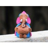 Artsy India brings you Colorful, Cheerful and Playful Ganesha idol made from Terracotta Clay. These are all Original designs made by local artisans.  Features: Unique and Special Design Handmade from (a type of clay) Painted with acrylic colors Colorful and Cheerful design Eco-friendly   Use: Gift to friends and family Gift festivals important events and other occasions As decorative showpiece figurine in your house / office Or simply to place it on shelf, table, show case, etc