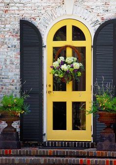 I love the yellow rounded door complete with shutters. I probably can't do the rounded, or the fantastic brick I just noticed. but the yellow yes, and the shutters. Cool Doors, The Doors, Entrance Doors, Windows And Doors, Doorway, Main Entrance, House Entrance, Beautiful Front Doors, Unique Doors
