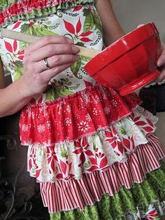 On this blog are instructions to make thiese adorable holiday aprons. So wish I could sew!!!!! http://purplechocolathome.blogspot.com/2010/12/christmas-aprons.html# Purple Chocolat Home: Christmas Aprons