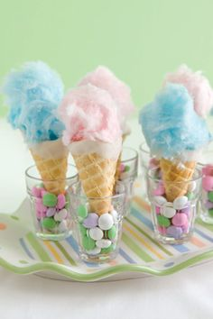 Gently break off top of waffle cones to make mini cones. Dip tops of cones into melted candy coating to coat top one-fourth of cone; place, pointed end up, on parchment paper to dry. Place cotton candy into and on top of prepared waffle cones. Cotton Candy Cone, Cotton Candy Party, Sweet Party, Ice Cream Candy, Festa Party, Partys, Easter Treats, Easter Food, Birthday Treats