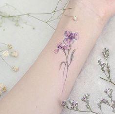 Iris flowers on wrist by Mini Lau