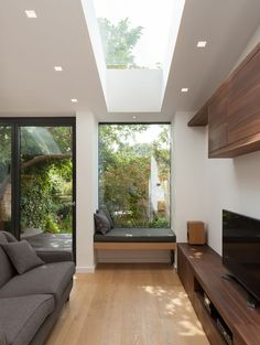 Skylight makes the ceiling higher. Combined with window seat (but missing under seat storage). Home Interior Design, Interior Architecture, Interior And Exterior, Kitchen Interior, House Extension Design, House Extensions, Modern House Design, Home And Living, Living Room