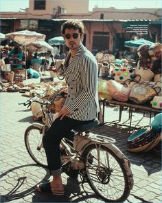 Riding a bike, Sam Webb wears Tagliatore, Etro, and Moncler for the pages of L'Officiel Hommes Ukraine.