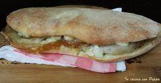 Il panuozzo è un panino enorme tipico della tradizione culinaria napoletana, molto diffuso a Gragnano, ma ormai conosciuto in tutta la regione...