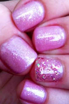 Shimmery soft pink shellac nails with one sparkly glitz nail