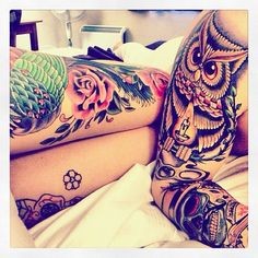 Tattooed couple. Love the skull and owl tattoo on him.