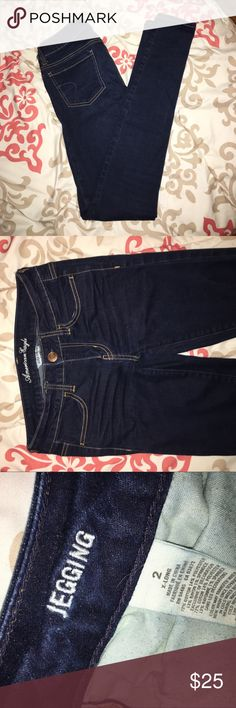 American Eagle skinnies Dark ink wash super stretch skinny jeans. These are jeggings but they have real front and back pockets and a zipper, and are 72% cotton. Medium-low rise. Extra long length! American Eagle Outfitters Jeans Skinny