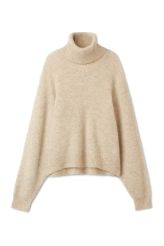 <p>The Lara Sweater brings a fine touch of luxe <strong>merino</strong> blend to your winter wardrobe. This slouchy sweater with a softly ribbed structure has a folded, loose turtleneck, dropped shoulders and raglan sleeves.<br /><br />- The model is 178 cm tall and wears size small, that measures 120 cm in chest circumference, 56 cm in length and 59 cm in sleeve length.<br /></p>