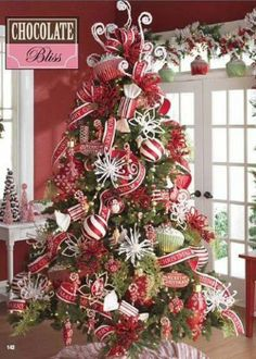 "WHIMSICAL TREE:  Love the white ""squigglies"" and snowflake bursts on this one.  The tree skirt looks like a mint!"