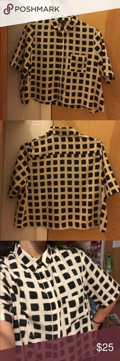 Topshop oversized crop blouse Kind of silky blouse from topshop. Cream coloured with I'm not sure if it's black or super dark blue brushstroke squares. There's also a pocket in the front. It's got an oversized fit and is slightly cropped. Super chic to wear in really any setting, since it can be dressed up or down or worn in a professional setting. In excellent condition. Topshop Tops Blouses