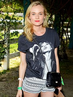 Music festival outfit idea: Diane Kruger at Coachella wearing a Mick Jagger T-shirt, printed shorts, a small leather crossbody and red lipstick