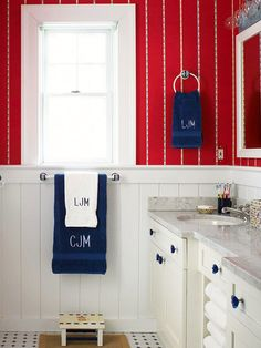 Decorating with Color: Red, White and Blue - Red wallpaper over white beadboard are accented with blue accessories in this cottage bathroom.