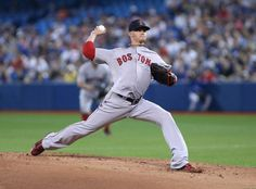 Boston Red Sox starting pitcher Clay Buchholz (11) delivers during first inning AL action against the Toronto Blue Jays in Toronto on Sunday, May 10, 2015.(Peter Power(/The Canadian Press via AP) MANDATORY CREDITBoston Red Sox Team Photos - ESPN