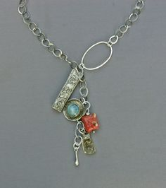 Mirinda Kossoff - charms of vintage sterling, coral, rutilated quartz, and blue ceramic