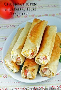 Chicken and Cream Cheese Taquitos - Tortillas rolled with a shredded chicken, cream cheese, cheddar, salsa and spinach filling with dipping sauces on the side for dunking. They have an addicting crunch that gives way to creamy, cheesy insides that will turn these into fast favorites.
