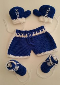Baby Boxing 3-6 Mos Gift Set. This gift set includes boxing shorts, boxing gloves and boxing shoes/boots. The color of this set is royal blue and white. Do you know a baby who is a fighter, a fighter