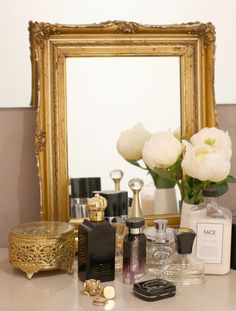 antique gold frame + a scent for every mood + treasured rings. vanity decor