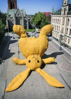 love. florentijn hofman. [The Big Yellow Rabbit is a temporary 13 meter high sculpture. It's an enlarged cuddle toy made out of swedish products thrown against the statue of Engelbrekt.]
