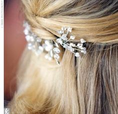 Marcia added freshwater pearl and Swarovski crystal hairpins by Toni Federici to her half-up hairstyle.
