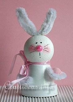 For this project you will need:    - small clay pot  - 35mm (1.4 inches) styrofoam ball  - white acrylic paint  - white chenille  - pink half pearl  - pink chalk (for blush)  - pink ribbon  - small pink egg  - strong craft glue  - permanent fine marker for the facial features    Ages 7 and older