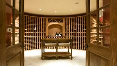 Large round wooden design wine cellar with tasting table. Walls are in brick and liquor cabinets are made of wood. Wine Rack Bar, Wine Cellar Racks, Kitchen Cabinets In Bathroom, Wine Cabinets, Wine In The Woods, Multi Luminaire, Home Wine Cellars, Wine Cellar Design, Tasting Room