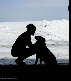 A silhouette of a woman with her dog